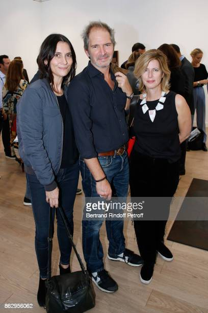 Director Christopher Thompson standing between his wife actress Geraldine Pailhas and his sister Caroline Thompson attend the FIAC 2017 International...