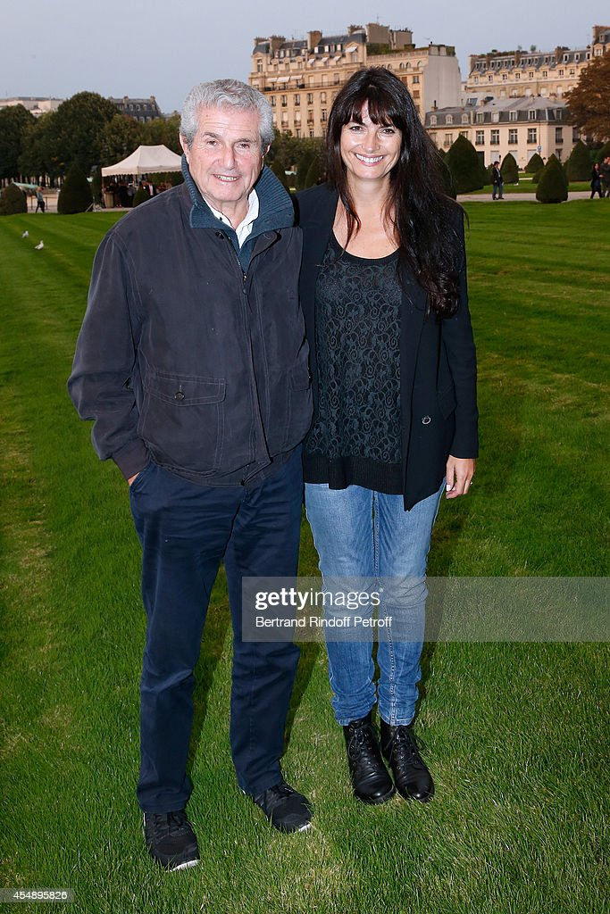 Director Claude Lelouch (L) and his companion Photographer Valerie Perrin attend the 'Claude Lelouch en Musique ! Held at the Invalides in Paris on September 6, 2014 in Paris, France.