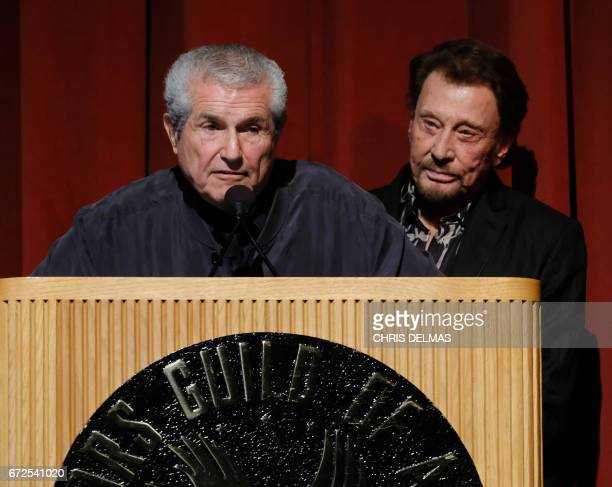 Director Claude Lelouch and singer Johnny Hallyday attend the Colcoa French Film Festival Opening night on April 24 2017 in Los Angeles California /...