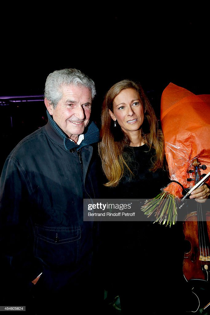 Director <a gi-track='captionPersonalityLinkClicked' href=/galleries/search?phrase=Claude+Lelouch&family=editorial&specificpeople=207051 ng-click='$event.stopPropagation()'>Claude Lelouch</a> and Violonist <a gi-track='captionPersonalityLinkClicked' href=/galleries/search?phrase=Anne+Gravoin&family=editorial&specificpeople=8536985 ng-click='$event.stopPropagation()'>Anne Gravoin</a> on stage at the end of the '<a gi-track='captionPersonalityLinkClicked' href=/galleries/search?phrase=Claude+Lelouch&family=editorial&specificpeople=207051 ng-click='$event.stopPropagation()'>Claude Lelouch</a> en Musique ! Held at the Invalides in Paris on September 6, 2014 in Paris, France.