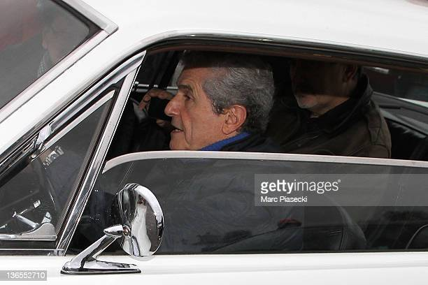 Director Claude Lelouch drives a Ford Mustang on the 'Place de la Concorde' during the 12th 'Touring Paris' on January 8 2012 in Paris France Vintage...
