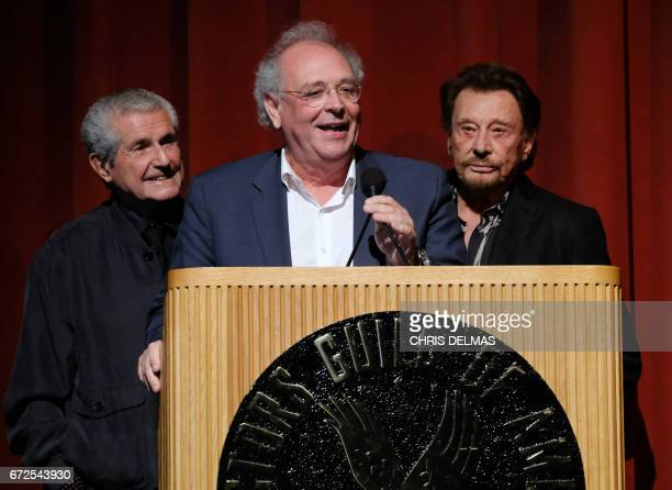 Director Claude Lelouch producer Samuel Hadida and singer Johnny Hallyday attend the Colcoa French Film Festival Opening night on April 24 2017 in...