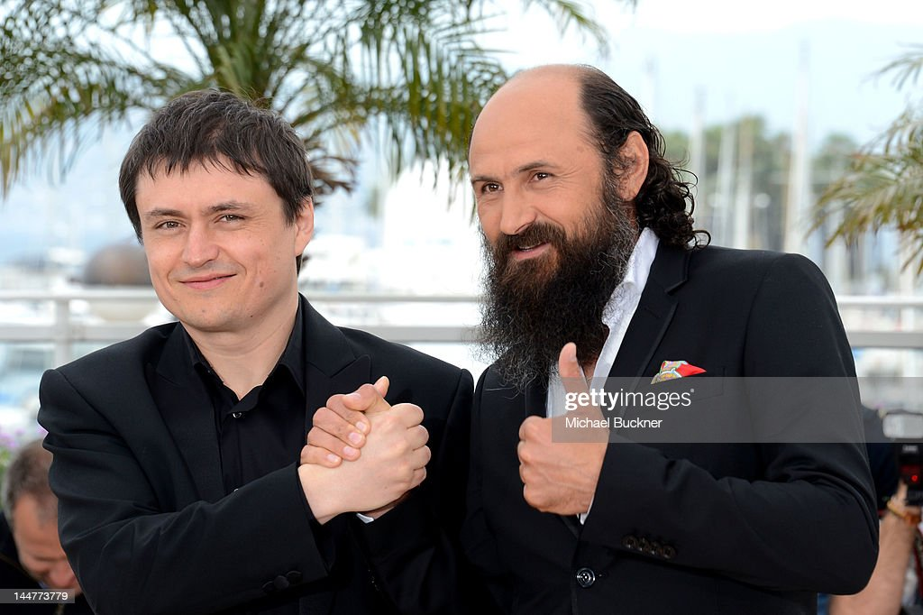 Director Cristian Mungiu and Actor Valeriu Andriuta pose at the 'Dupa Dealuri' photocall during the 65th Annual Cannes Film Festival at Palais des Festivals on May 19, 2012 in Cannes, France.