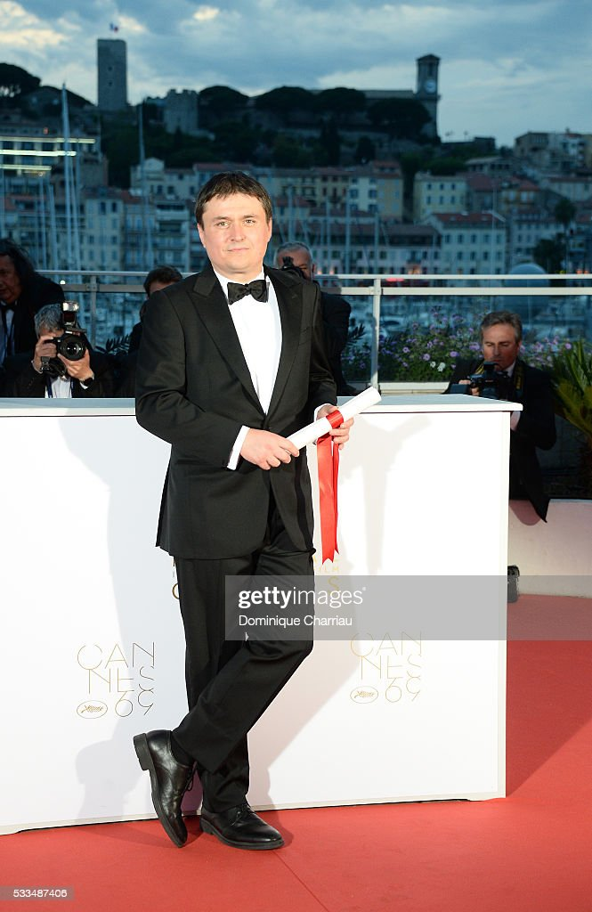 Director <a gi-track='captionPersonalityLinkClicked' href=/galleries/search?phrase=Cristian+Mungiu&family=editorial&specificpeople=4292523 ng-click='$event.stopPropagation()'>Cristian Mungiu</a> poses after receiving the Best Director prize for the movie 'Graduation (Bacalaureat)' at the Palme D'Or Winner Photocall during the 69th annual Cannes Film Festival at the Palais des Festivals on May 22, 2016 in Cannes, France.