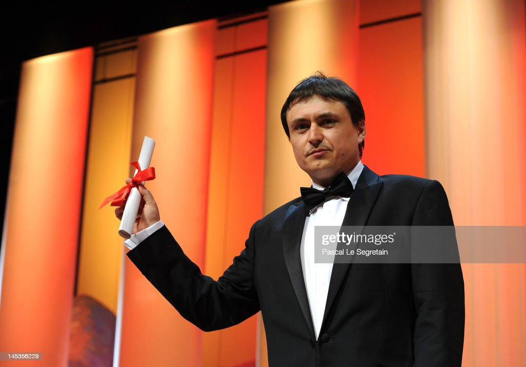 Director <a gi-track='captionPersonalityLinkClicked' href=/galleries/search?phrase=Cristian+Mungiu&family=editorial&specificpeople=4292523 ng-click='$event.stopPropagation()'>Cristian Mungiu</a> receives Award for Best Screenplay for Beyond the Hills onstage at the Closing Ceremony during the 65th Annual Cannes Film Festival on May 27, 2012 in Cannes, France.