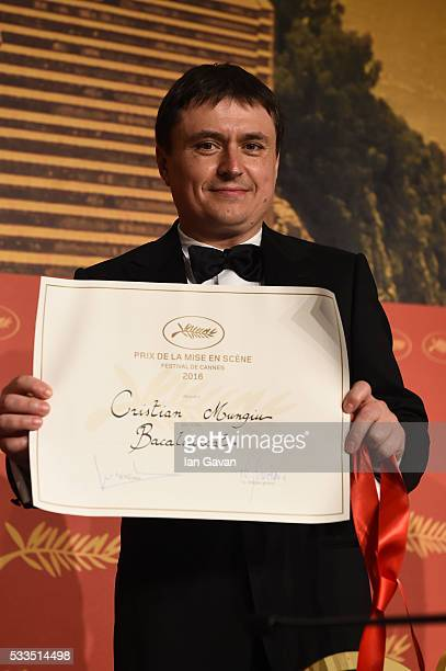 Director Cristian Mungiu winner of the award for Best Director for the movie 'Bacalaureat' attends the Palme D'Or Winner Press Conference during the...