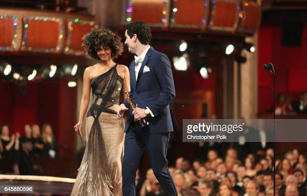 Director Damien Chazelle accepts Best Director for 'La La Land' from presenter Halle Berry onstage during the 89th Annual Academy Awards at Hollywood...