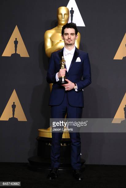 Director Damien Chazelle poses in the press room at the 89th annual Academy Awards at Hollywood Highland Center on February 26 2017 in Hollywood...