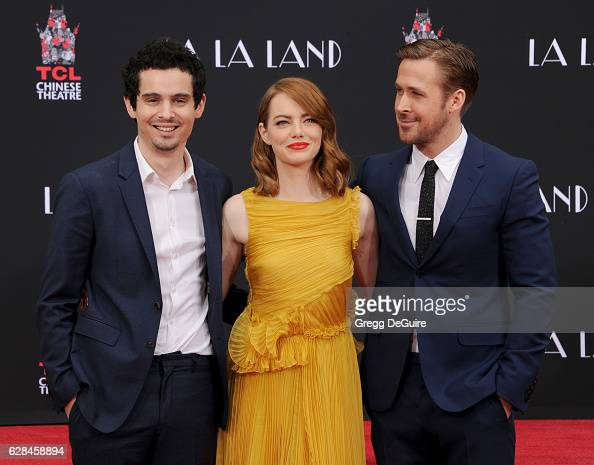 Director Damien Chazelle poses with actors Emma Stone and Ryan Gosling who are honored with a Hand and Footprint Ceremony at TCL Chinese Theatre IMAX...