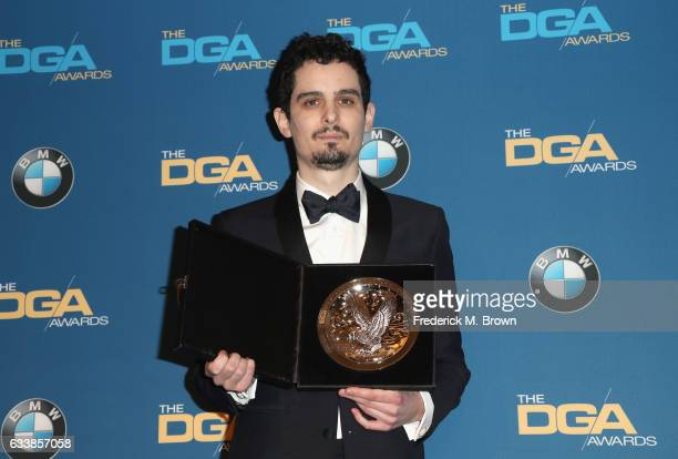 "Director Damien Chazelle recipient of the Feature Film Nomination Plaque for ""La La Land"" poses in the press room during the 69th Annual Directors..."