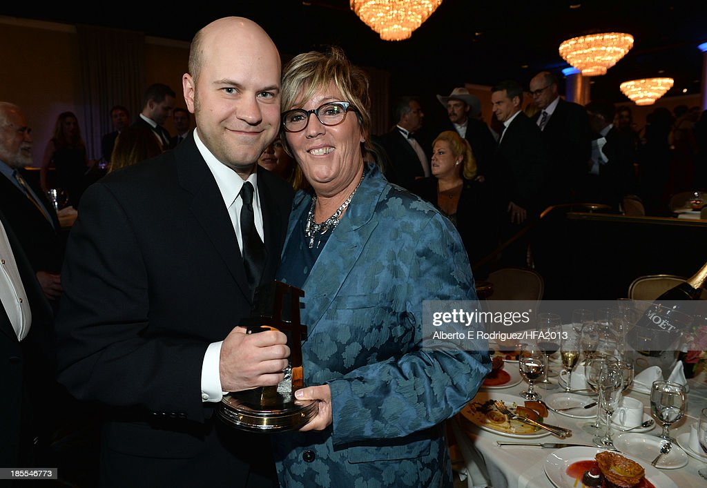 Director Dan Scanlon (L), recipient of the Hollywood Animation Award for 'Monsters University' and producer Kori Rae pose together during the 17th annual Hollywood Film Awards at The Beverly Hilton Hotel on October 21, 2013 in Beverly Hills, California.