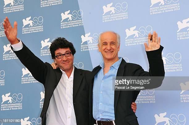 Director Daniele Cipri and actor Toni Servillo attend the 'E Stato Il Figlio' Photocall during the 69th Venice International Film Festival at Palazzo...