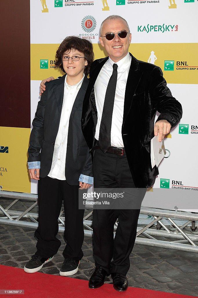 Director Daniele Luchetti (R) and his son Federico arrive at 2011 Premi David di Donatello Italian Academy Awards at Auditorium della Conciliazione on May 6, 2011 in Rome, Italy.