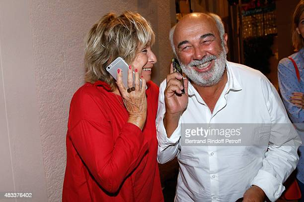 Director Daniele Thompson and Gerard Jugnot pose Backstage after the 'La colere du Tigre' Theater play during the 31th Ramatuelle Festival Day 6 on...