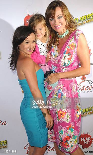 Director Danielle Harris and actress Tanya Newbould arrive for the cast/crew screening of 'Among Friends' held at the Jon Lovitz Comedy Club on April...