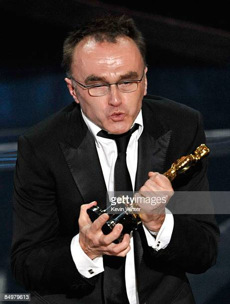 Director Danny Boyle accepts his Best Director award for 'Slumdog Millionaire' during the 81st Annual Academy Awards held at Kodak Theatre on...