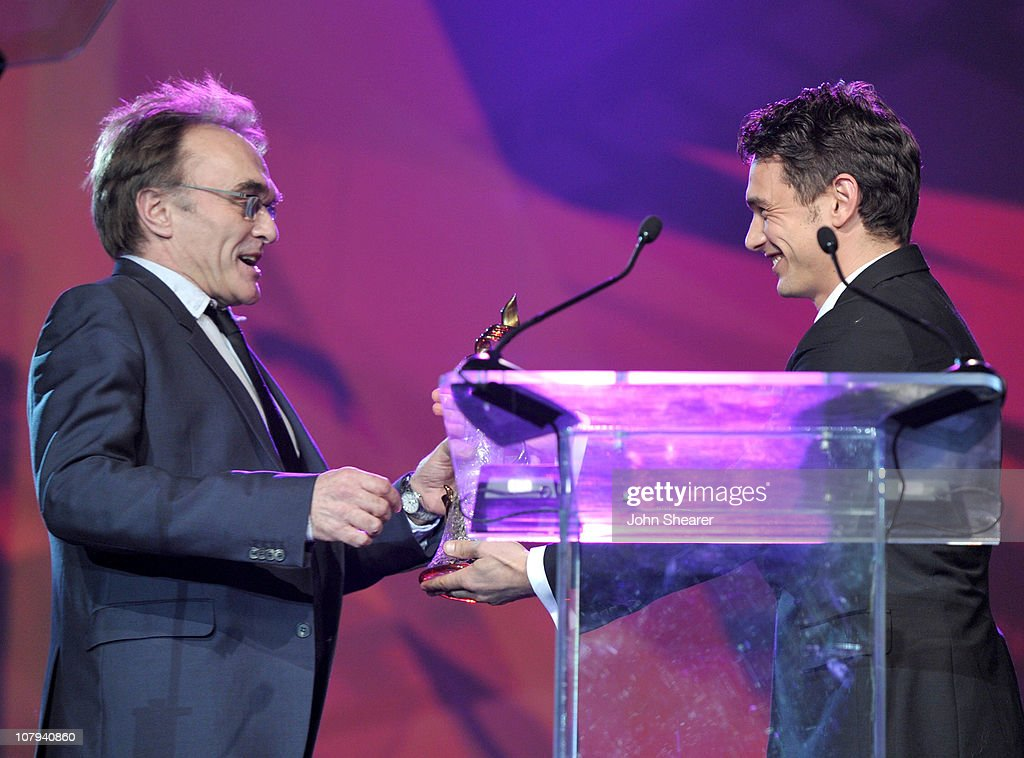 Director Danny Boyle accepts the Sonny Bono Visionary Award from actor James Franco at the 22nd Annual Palm Springs International Film Festival Awards Gala at the Palm Springs Convention Center on January 8, 2011 in Palm Springs, California.