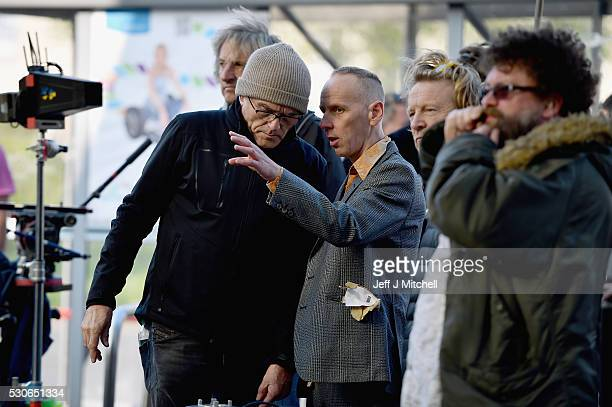 Director Danny Boyle and actor Ewan Bremner on the set of the Trainspotting film sequel in Muirhouse shopping centre on May 11 2016 in Edinburgh...