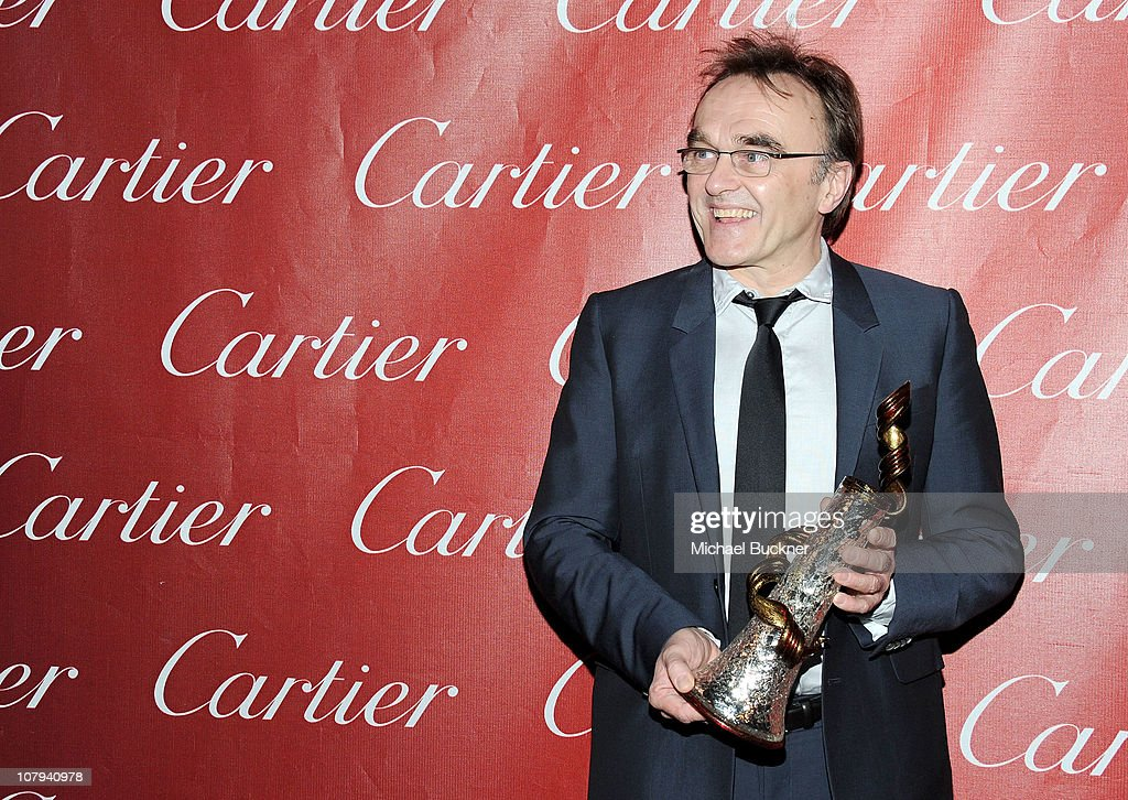 Director Danny Boyle poses backstage with his Sonny Bono Visionary Award at the 22nd Annual Palm Springs International Film Festival Awards Gala at the Palm Springs Convention Center on January 8, 2011 in Palm Springs, California.