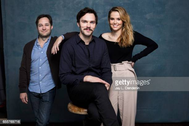 Director Danny Strong actor Nicholas Hoult and actress Zoey Deutch from the film Rebel in the Rye are photographed at the 2017 Sundance Film Festival...