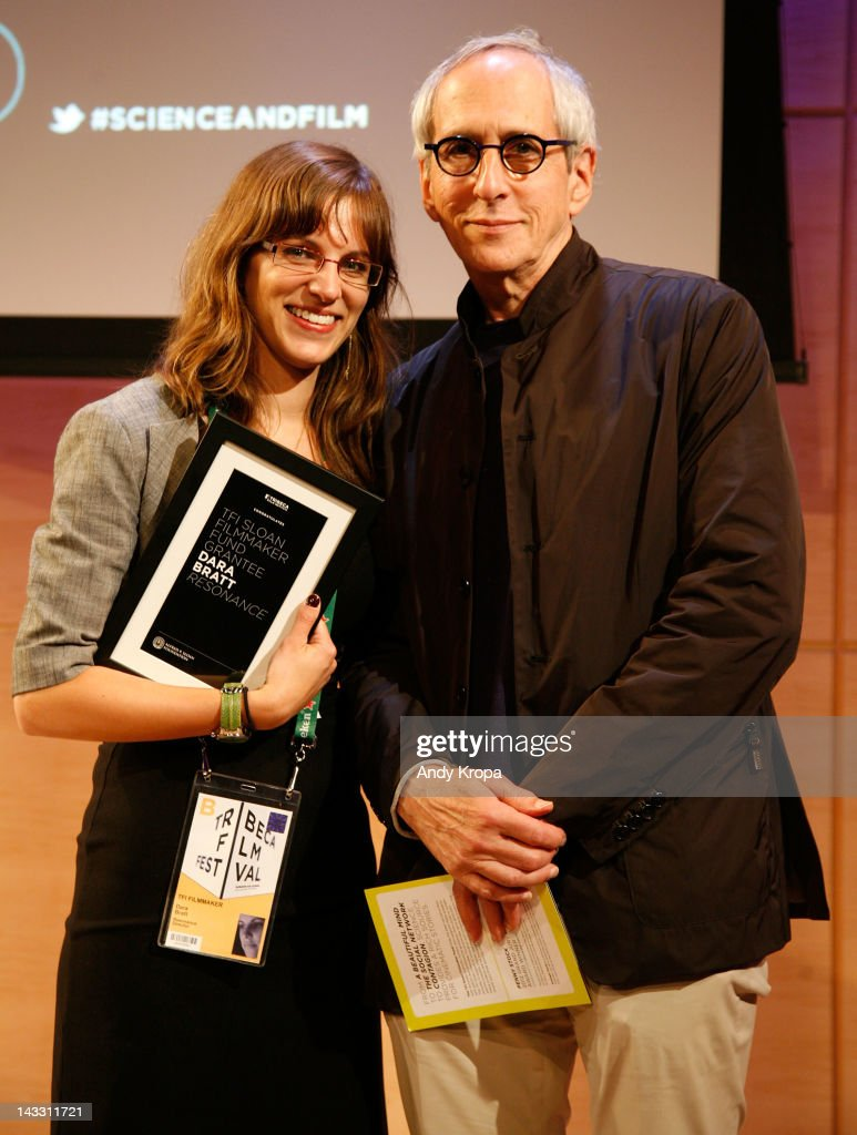 Director Dara Bratt and Producer <a gi-track='captionPersonalityLinkClicked' href=/galleries/search?phrase=Michael+Shamberg&family=editorial&specificpeople=861594 ng-click='$event.stopPropagation()'>Michael Shamberg</a> pose for a photograph at the Sloan WIP Readings & Cocktails during the 2012 Tribeca Film Festival at the Green Space on April 23, 2012 in New York City.