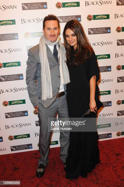 Director Darren Aronofsky and actress Mila Kunis attend the 'Black Swan' afterparty during the 54th BFI London Film Festival at the Royal Opera House...