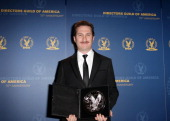 """Director Darren Aronofsky recipient of the Feature Film Nomination Plaque for """"Black Swan"""" poses in the press room at the 63rd Annual Directors Guild..."""