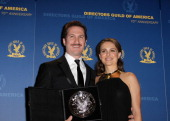 """Director Darren Aronofsky recipient of the Feature Film Nomination Plaque for """"Black Swan"""" poses in the press room with presenter Natalie Portman at..."""