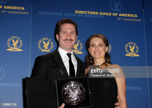 "Director Darren Aronofsky recipient of the Feature Film Nomination Plaque for ""Black Swan"" poses in the press room with presenter Natalie Portman at..."