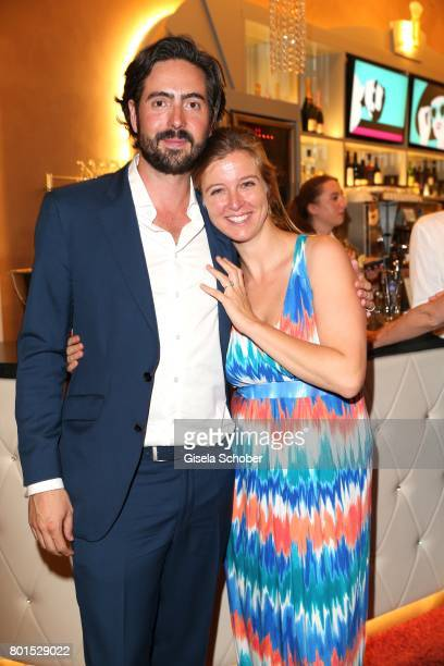 Director David Dietl and Nina Eichinger attend the premiere of the movie 'Ella's Baby' during the film festival Munich at Gloria Palast on June 26...