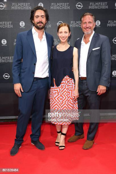 Director David Dietl Katharina Schuettler and Benno Fuermann during the premiere of the movie 'Ella's Baby' during the film festival Munich at Gloria...