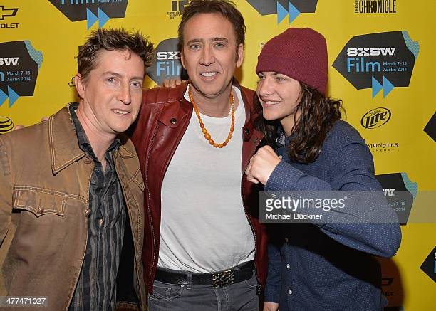 Director David Gordon Green actor Nicholas Cage and actor Tye Sheridan pose for photos in the green room for the premiere of 'Joe' during the 2014...