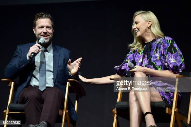 Director David Leitch and actor Charlize Theron speak onstage at CinemaCon 2017 Universal Pictures Invites You to a Special Presentation Featuring...