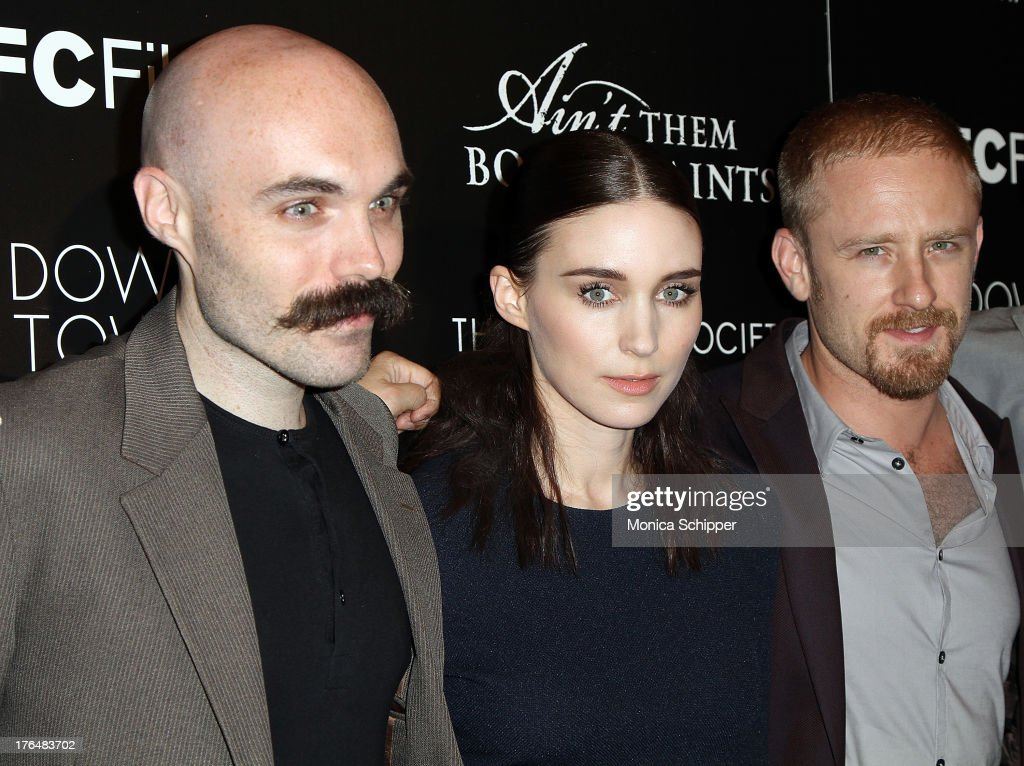 Director David Lowery, actress <a gi-track='captionPersonalityLinkClicked' href=/galleries/search?phrase=Rooney+Mara&family=editorial&specificpeople=5669181 ng-click='$event.stopPropagation()'>Rooney Mara</a> and actor Ben Foster attend the Downtown Calvin Klein with The Cinema Society screening of IFC Films' 'Ain't Them Bodies Saints' at The Museum of Modern Art on August 13, 2013 in New York City.
