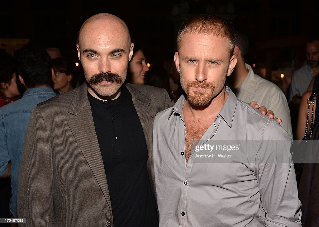 Director David Lowery and actor Ben Foster attend the Downtown Calvin Klein with The Cinema Society screening of IFC Films' 'Ain't Them Bodies Saints' after party at Refinery Rooftop on August 13, 2013 in New York City.