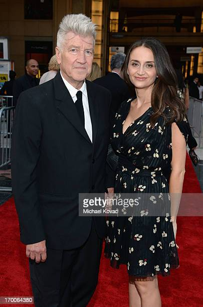 Director David Lynch and actress Emily Stofle attend 41st AFI Life Achievement Award Honoring Mel Brooks at Dolby Theatre on June 6 2013 in Hollywood...