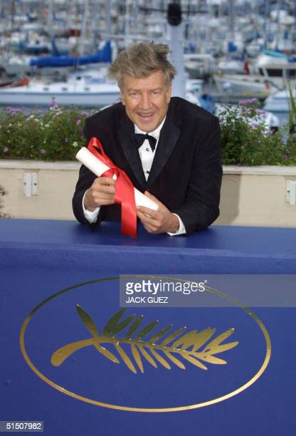 US director David Lynch celebrates his award at the Palais des Festivals after receiving the 54th Cannes Film Festival Directing Prize for his movie...