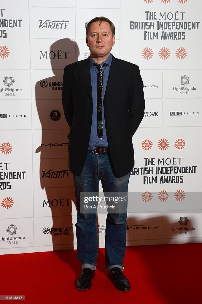 Director David MacKenzie arrives on the red carpet for the Moet British Independent Film Awards at Old Billingsgate Market on December 8 2013 in...
