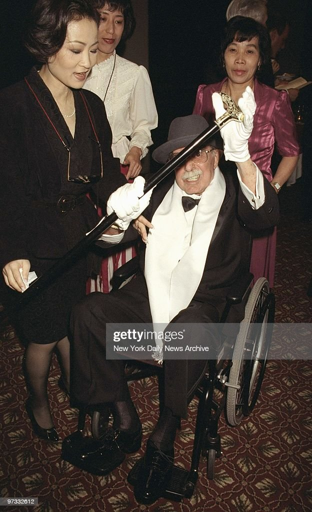 Director David Merrick attending the Tony Awards party at the Marriott Marquis. Upon seeing photographer he lifted his cane in a threatening manner.