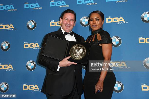 Director David Nutter winner of the award forOutstanding Directorial Achievement in Dramatic Series for 'Game of Thrones' poses with Actress/Director...