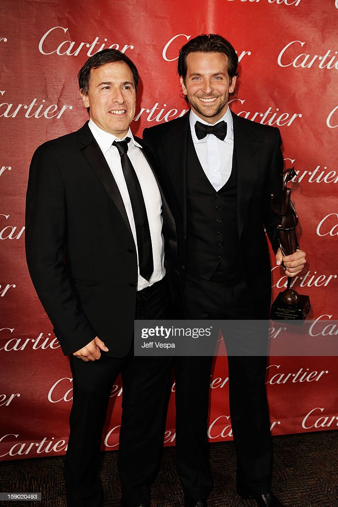 Director David O. Russell and Actor Bradley Cooper pose with the Desert Palm Achievement Award during the 24th annual Palm Springs International Film Festival Awards Gala at the Palm Springs Convention Center on January 5, 2013 in Palm Springs, California.