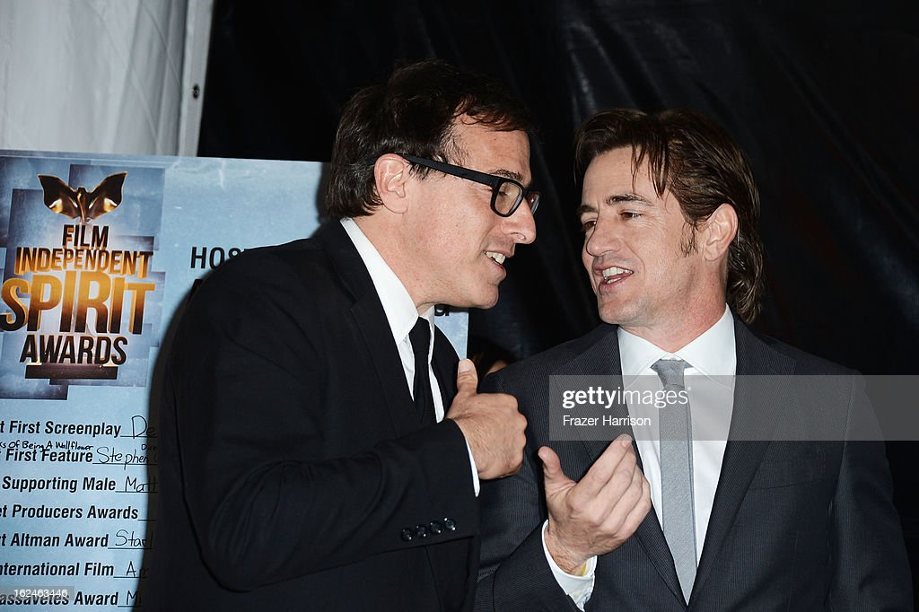 Director <a gi-track='captionPersonalityLinkClicked' href=/galleries/search?phrase=David+O.+Russell&family=editorial&specificpeople=215306 ng-click='$event.stopPropagation()'>David O. Russell</a> and actor <a gi-track='captionPersonalityLinkClicked' href=/galleries/search?phrase=Dermot+Mulroney&family=editorial&specificpeople=208776 ng-click='$event.stopPropagation()'>Dermot Mulroney</a> talk in the press room during the 2013 Film Independent Spirit Awards at Santa Monica Beach on February 23, 2013 in Santa Monica, California.