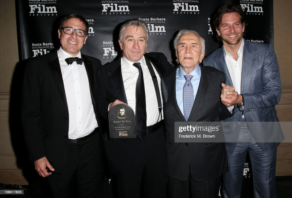 Director <a gi-track='captionPersonalityLinkClicked' href=/galleries/search?phrase=David+O.+Russell&family=editorial&specificpeople=215306 ng-click='$event.stopPropagation()'>David O. Russell</a>, and actors <a gi-track='captionPersonalityLinkClicked' href=/galleries/search?phrase=Robert+De+Niro&family=editorial&specificpeople=201673 ng-click='$event.stopPropagation()'>Robert De Niro</a>, <a gi-track='captionPersonalityLinkClicked' href=/galleries/search?phrase=Kirk+Douglas+-+Actor&family=editorial&specificpeople=13450359 ng-click='$event.stopPropagation()'>Kirk Douglas</a> and <a gi-track='captionPersonalityLinkClicked' href=/galleries/search?phrase=Bradley+Cooper&family=editorial&specificpeople=680224 ng-click='$event.stopPropagation()'>Bradley Cooper</a> attend the SBIFF's 2012 <a gi-track='captionPersonalityLinkClicked' href=/galleries/search?phrase=Kirk+Douglas+-+Actor&family=editorial&specificpeople=13450359 ng-click='$event.stopPropagation()'>Kirk Douglas</a> Award For Excellence In Film during the Santa Barbara Film Festival on December 8, 2012 in Goleta, California.