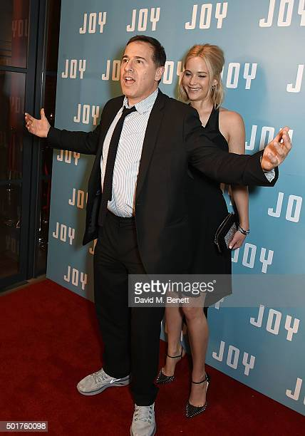 Director David O Russell and actress Jennifer Lawrence attend a special screening of 'Joy' at the Ham Yard Hotel on December 17 2015 in London England