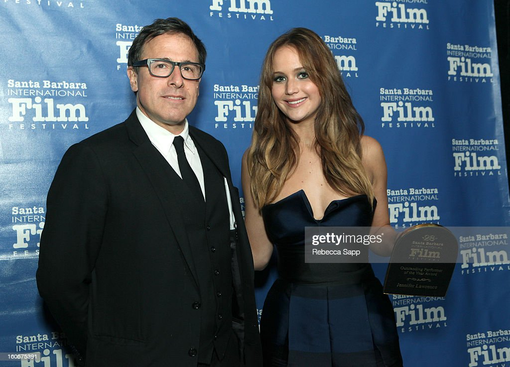 Director <a gi-track='captionPersonalityLinkClicked' href=/galleries/search?phrase=David+O.+Russell&family=editorial&specificpeople=215306 ng-click='$event.stopPropagation()'>David O. Russell</a> and actress <a gi-track='captionPersonalityLinkClicked' href=/galleries/search?phrase=Jennifer+Lawrence&family=editorial&specificpeople=1596040 ng-click='$event.stopPropagation()'>Jennifer Lawrence</a> attend the 28th Santa Barbara International Film Festival Outstanding Performer Of The Year Presented To <a gi-track='captionPersonalityLinkClicked' href=/galleries/search?phrase=Jennifer+Lawrence&family=editorial&specificpeople=1596040 ng-click='$event.stopPropagation()'>Jennifer Lawrence</a> on February 2, 2013 in Santa Barbara, California.