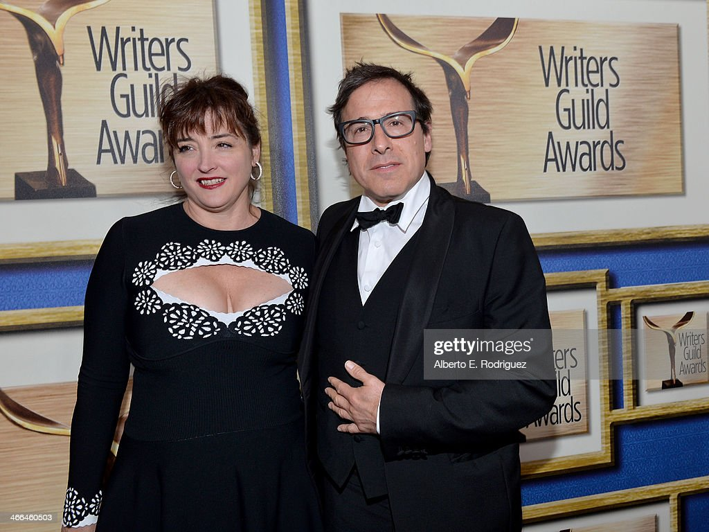 Director <a gi-track='captionPersonalityLinkClicked' href=/galleries/search?phrase=David+O.+Russell&family=editorial&specificpeople=215306 ng-click='$event.stopPropagation()'>David O. Russell</a> (R) and Holly Davis attend the 2014 Writers Guild Awards L.A. Ceremony at J.W. Marriott at L.A. Live on February 1, 2014 in Los Angeles, California.