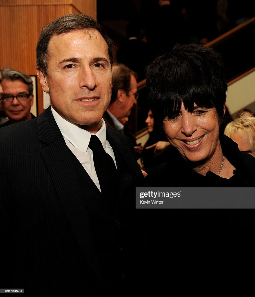 Director David O. Russell (L) and songwriter Diane Warren pose at the after party for a screening of The Weinstein Company's 'Silver Lining's Playbook' at the Academy of Motion Picture Arts and Sciences on November 19, 2012 in Beverly Hills, California.