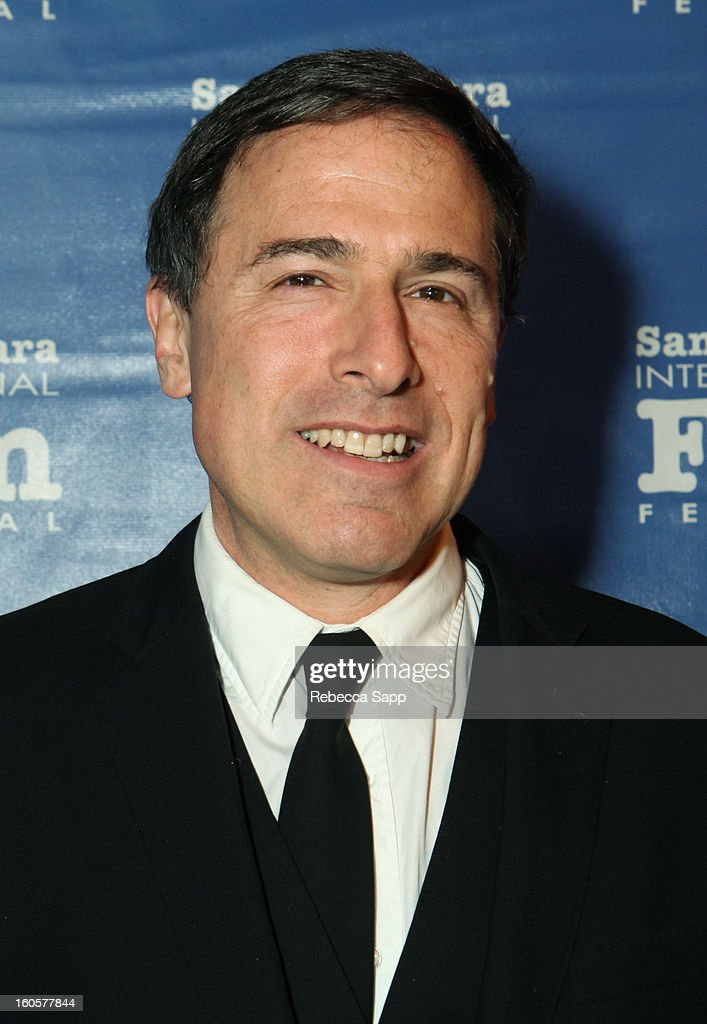 Director <a gi-track='captionPersonalityLinkClicked' href=/galleries/search?phrase=David+O.+Russell&family=editorial&specificpeople=215306 ng-click='$event.stopPropagation()'>David O. Russell</a> attends the 28th Santa Barbara International Film Festival Outstanding Performer Of The Year Presented To Jennifer Lawrence on February 2, 2013 in Santa Barbara, California.