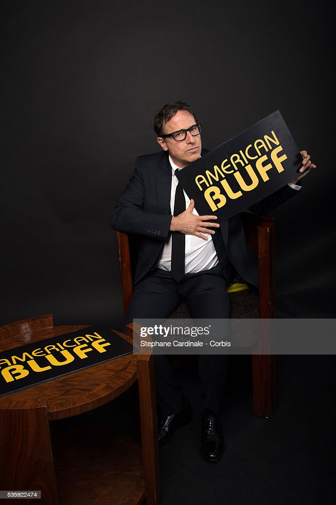 Director David O. Russell poses at a photo session during the 'American Bluff' Party at Pavillon Champs Elysees, in Paris.