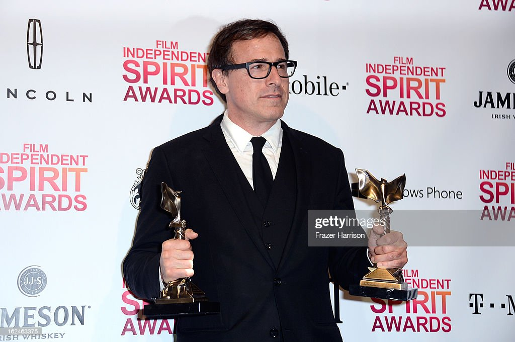 Director <a gi-track='captionPersonalityLinkClicked' href=/galleries/search?phrase=David+O.+Russell&family=editorial&specificpeople=215306 ng-click='$event.stopPropagation()'>David O. Russell</a> poses with the Best Director and Best Screenplay awards for 'Silver Linings Playbook' in the press room during the 2013 Film Independent Spirit Awards at Santa Monica Beach on February 23, 2013 in Santa Monica, California.